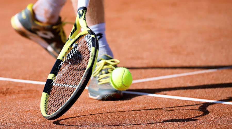 Tennis player attempting to play a shot.
