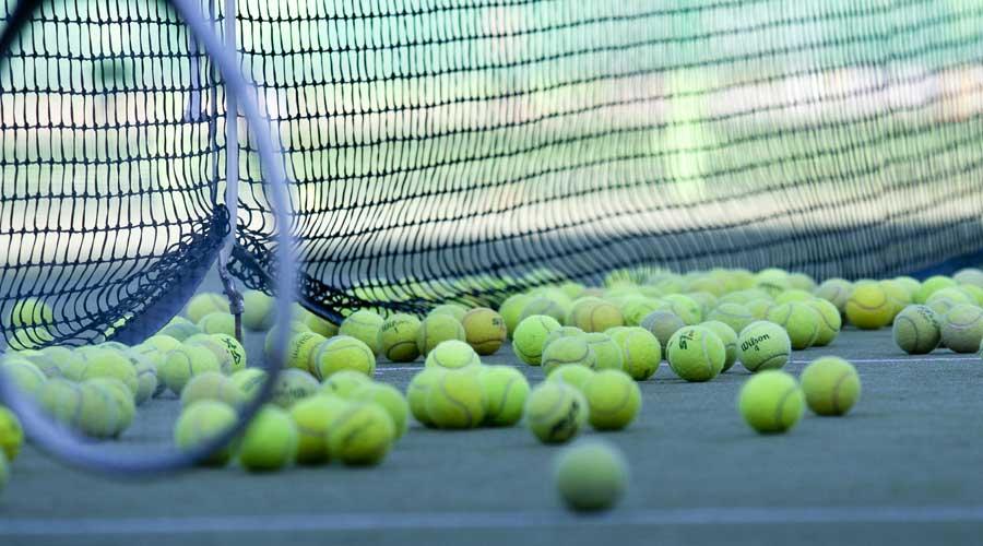 Tennis balls at the net.