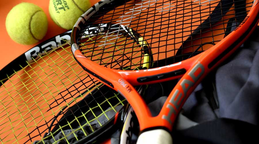Tennis balla and racquets.