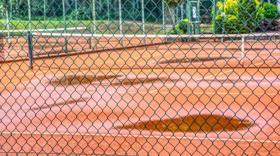 Wet tennis court after rain.