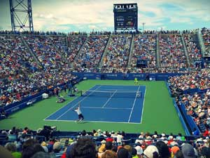 Trading a tennis match in a full stadium
